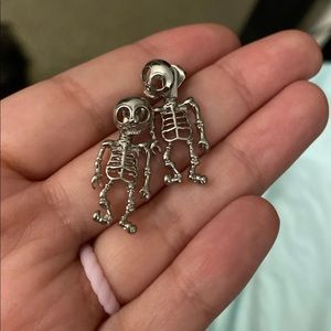 skeleton earrings.